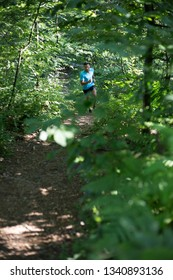 Young man running in the woods
