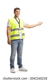 Young man in a safety vest showing with hand isolated on white background