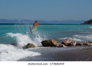 young man sail on a windsurfer, Rhodes Greece