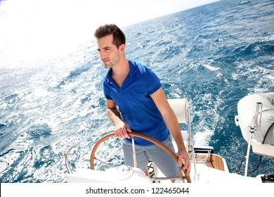 Young man sailing in caribbean sea