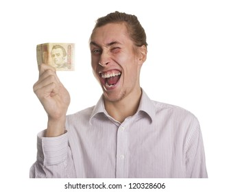 Young man with a salary Ukrainian money and showing joy