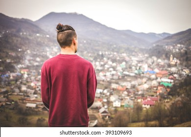 Young Man With Samurai Haircut in the Mountain Countryside