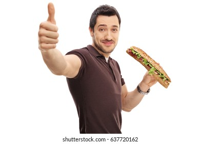 Young man with a sandwich making a thumb up sign isolated on white background