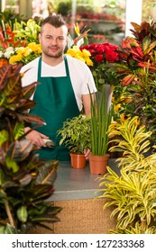 Young man scanning bar-code flower shop gardening florist