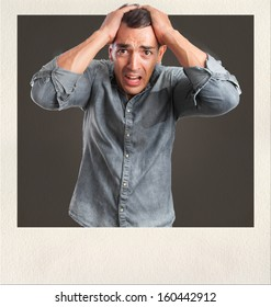 young man scared gesture on photo frame