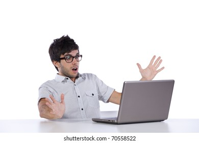 young man scared with something he see on his laptop computer