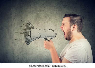 Young man screaming in loudspeaker making an announcement