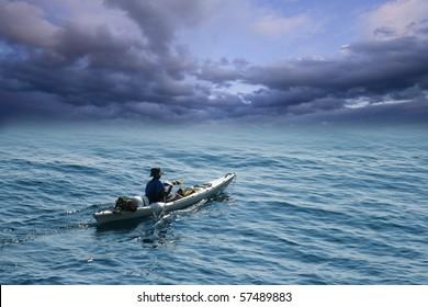 Young man in sea kayak