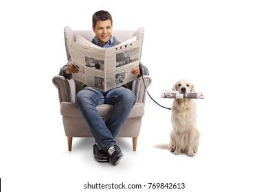Young man seated in an armchair reading a newspaper and a labrador retriever with a newspaper isolated on white background