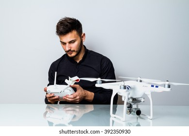 Young Man setting up a drone for first fly indoor