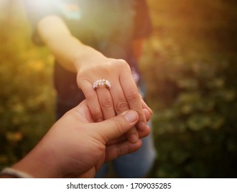 A young man shakes hands with a young woman for getting married.