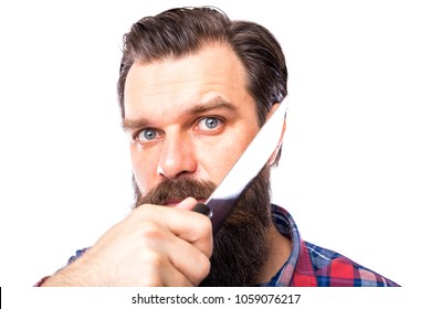 young man shaving his beard with butcher knife on white background