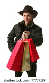 Young man with shopping bags wearing winter clothes isolated on white