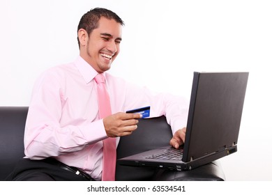 Young man shopping with his credit card on internet