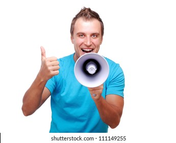 Young man shouting loud into the megaphone showing thumbs up