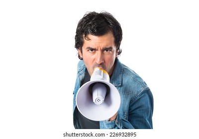 Young man shouting over isolated white background