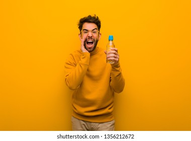 Young man shouting something happy to the front