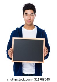 Young man show with the empty chalkboard