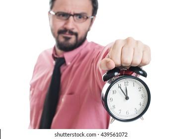 Young man showing an alarm clock