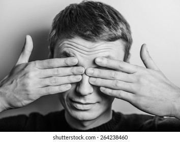 Young man in showing fatigue, sleepy, sleepy, closes his eyes with his hands. gesture. photo shoot.