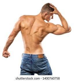 Young man showing his muscular back on white background