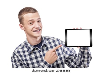 Young man showing on tablet computer with empty screen.
