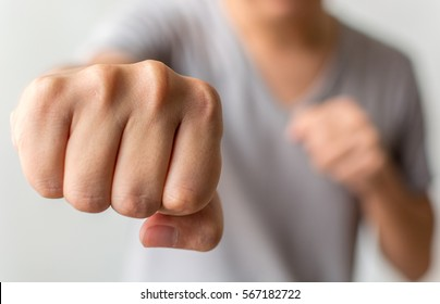Young man showing punch a fist
