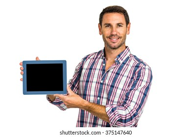 Young man showing tablet screen at camera on white screen