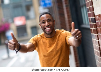 young man showing a thumbs up symbol