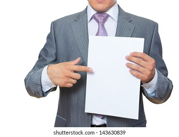Young man shows blank paper isolated on white