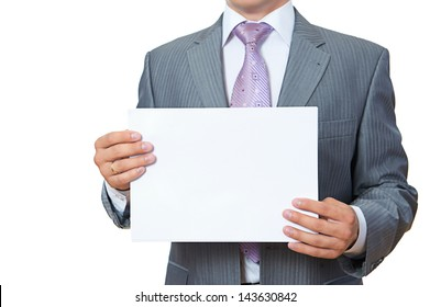 Young man shows blank paper