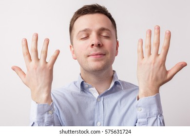 young man shows a clean finger. He closes his eyes dreamily.