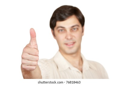"""A young man shows a gesture of """"Excellent"""""""