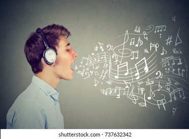 Young man singing with music notes coming out of mouth