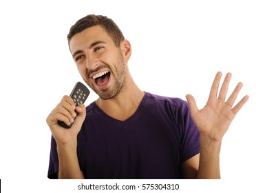 Young man singing while holding a remote control
