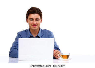 A young man sitting in front of a laptop