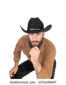 A young man sitting on a chair bending forwards wearing a black