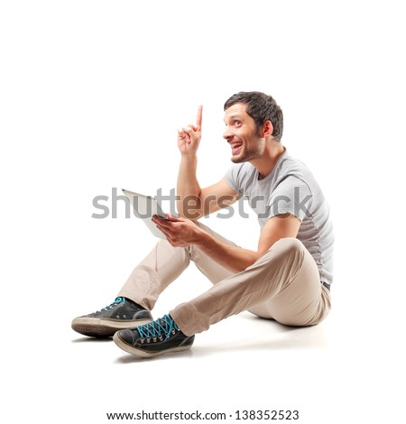 young man sitting on the floor has an idea