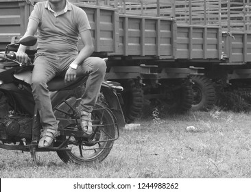 Young man sitting on a motorbike.