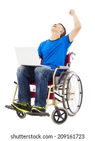 young man sitting on a wheelchair and  excited to raise arm