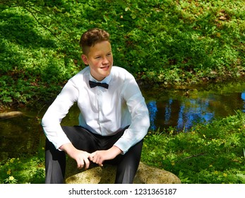 Young man sitting outdoors and thinking and day dreaming about his future