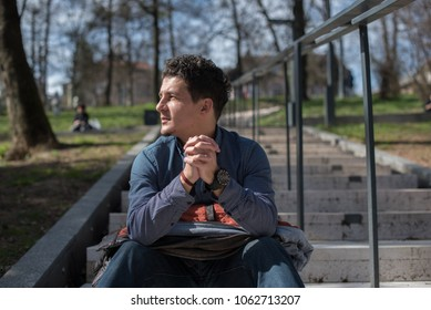 young man in skate park sitting on rails