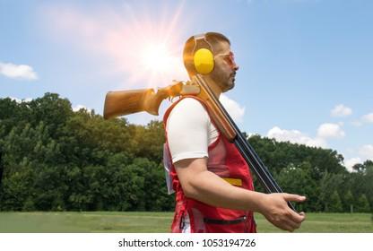 Young man skeet shooting outdoors