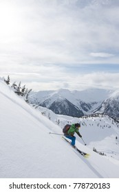 A young man skiing in the mountains near Terrace, British Columbia, Canada.