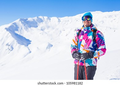 Young man with skis and a ski outfit in the Zillertal Arena, Austria