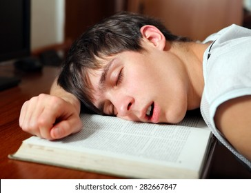 Young Man sleep on the Book at the Home