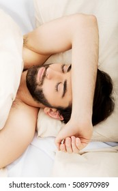 Young man sleeping in bed.