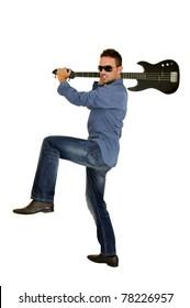 Young man smashing a guitar