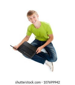 Young man smile sitting with laptop on floor looking at camera, casual wear jeans and green shirt isolated over white background top angle view