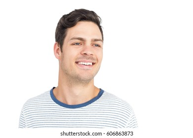 Young man smiling at camera on white background